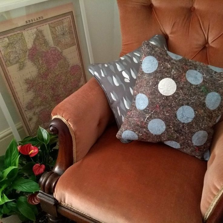 Cosy nook with antique velvet armchair and screenprinted cushions