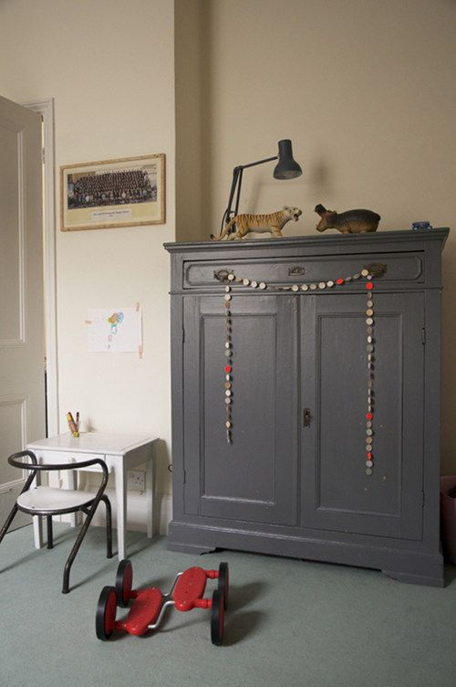 """Sneak Peek: Best of Gray. """"Benedicte Sartorio found this antique wardrobe at the Paris flea market and painted it a dark gray. It's the perfect storage unit for the children's room."""" #sneakpeek"""