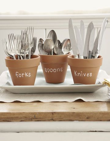 Quick party tip: Set silverware out in pretty terra-cotta pots. Label each container using chalk, so you can wipe off the writing and reuse the pots.