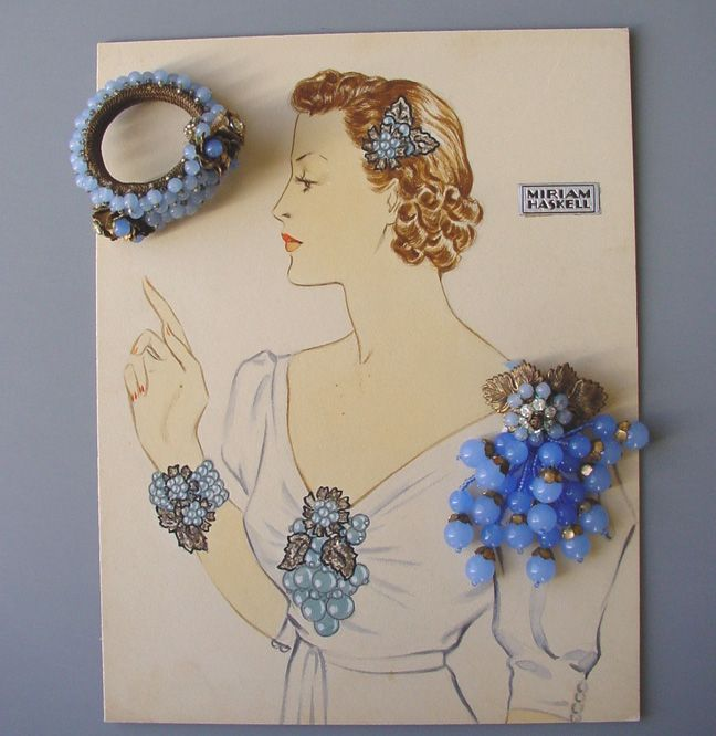 Miriam Haskell - Hess jewelry illustrated in Larry Austin original art work, this one shows the silvery leaves and blue glass bead coil bracelet, hair clip and dress clip on a lady wearing a white dress, circa 1940