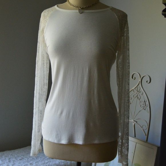 Ivory Elegant Lace Long Sleeves Scoop Neck Tunic Define comfort? Define cute  and here you go!! Covers tush. Fits loose but not sloppy loose. Lace sleeves turn an ordinary tee in extraordinary. Forever 21 Tops Tunics