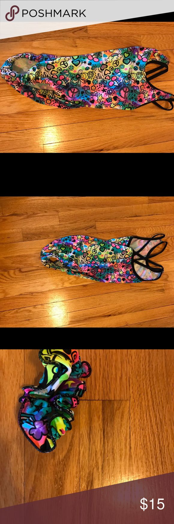 Snowflake leotard with matching scrunchie This is a fun, colorful, and comfortable leotard which comes with a matching scrunchie. On the back their is a gorgeous crisscross straps. It is in great condition Other