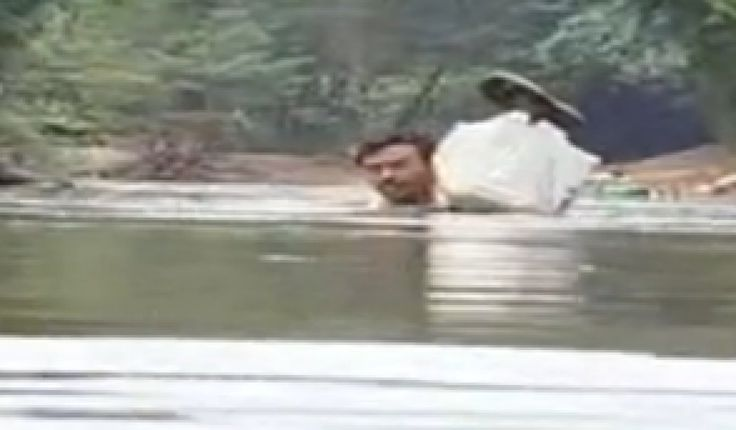 This Dedicated Teacher Swims Through A River To Get To School Each Day  One teacher in Malappuram, India, will not let anything keep him from reaching his students -- not even a river. Each day, Abdul Mallik wades through neck-high water to get to the primary school where he's worked for 20 years, NDTV reports.  Why? Because it's the fastest way to get to class.
