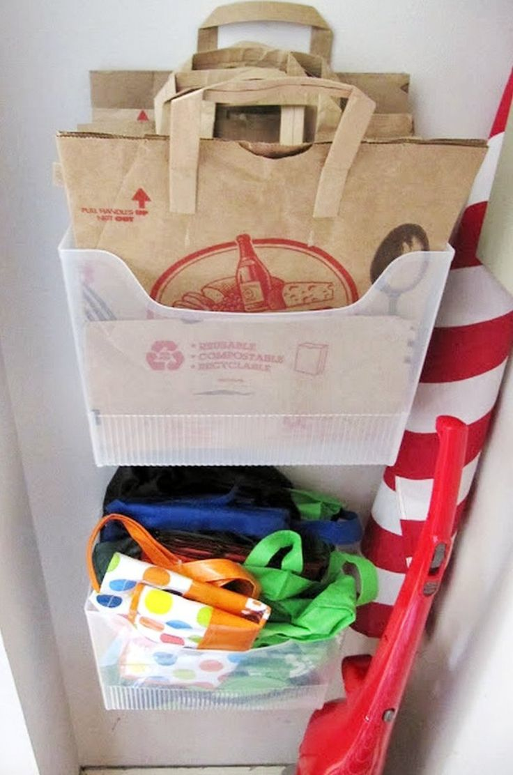 Right now there's a cupboard in my kitchen stuffed with reusable grocery totes and paper bags. Periodically I try to straighten everything, but the area inevitably gets messy again, with bags falling out and on me whenever I open the door. I've never found a great way to store bags, but this solution from Everyday Organizing, which uses plastic file boxes hung on the wall as grocery bag bins, gives me hope. Isn't it clever?