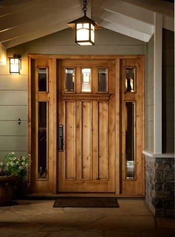 This Craftsman bungalow style wood entry door with two 2-sidelights. Antigua Doors worked directly with the homeowner on the door design, suggesting opening up the sidelights to maximize natural light. This wood front door is mocha stain on Knotty Alder.