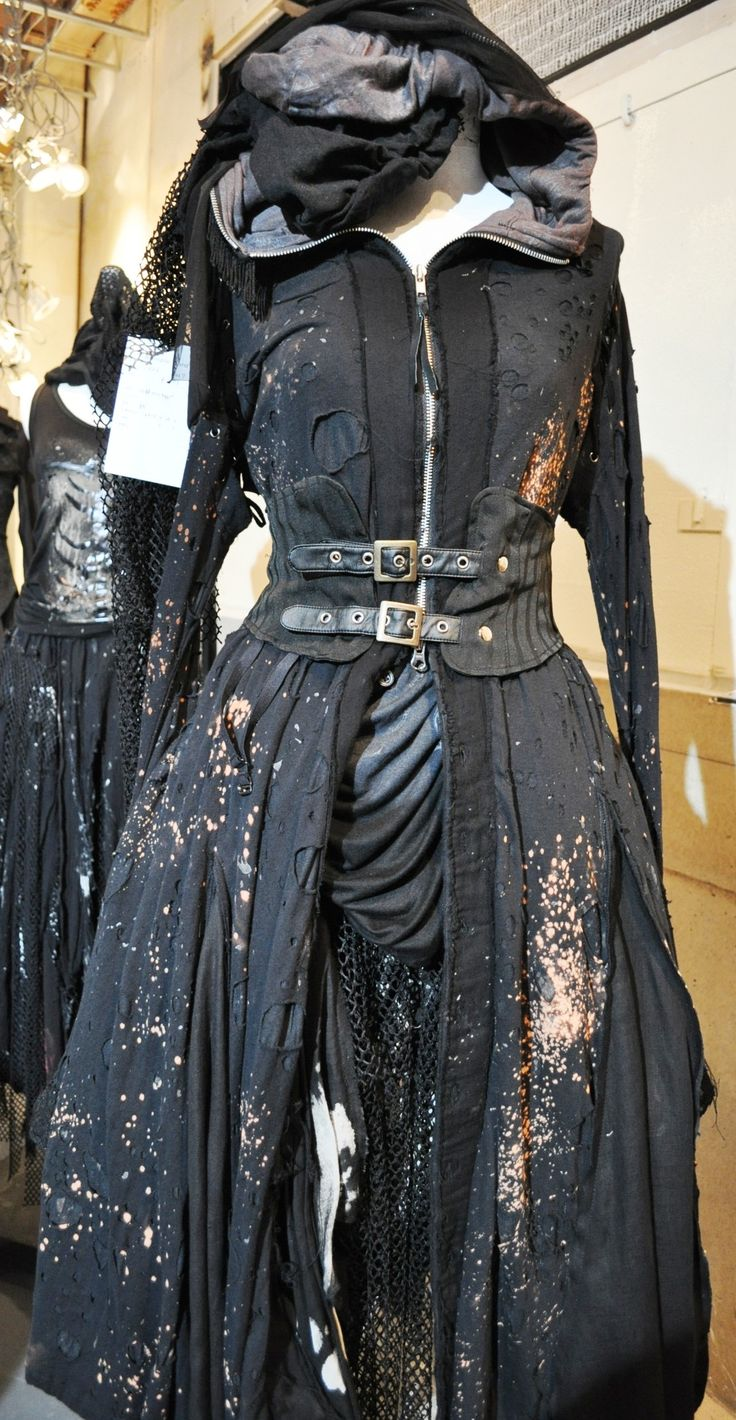 apocalyptic black buckled long coat, distressed. this thing really looks like it's been through hell and back. Oh my god. I need this I'm my life!!!!