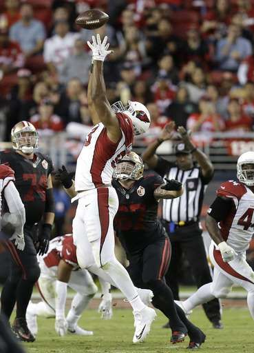 Arizona Cardinals defensive end Calais Campbell, center, intercepts a San Francisco 49ers pass during the first half of an NFL football game in Santa Clara, Calif., Thursday, Oct. 6, 2016.
