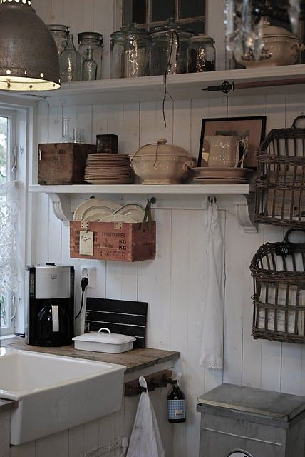 Jars on shelves and a farmhouse sink