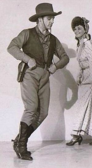 James Cagney dances around Rosemary Lane during an Oklahoma Kid publicity shot