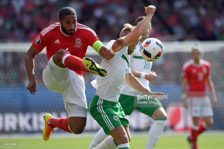 Ashley Williams of Wales battles with Stuart Dallas of Northern Ireland during the UEFA EURO 2016 round of 16 match between Wales and Northern Ireland at Parc des Princes on June 25, 2016 in Paris, France.