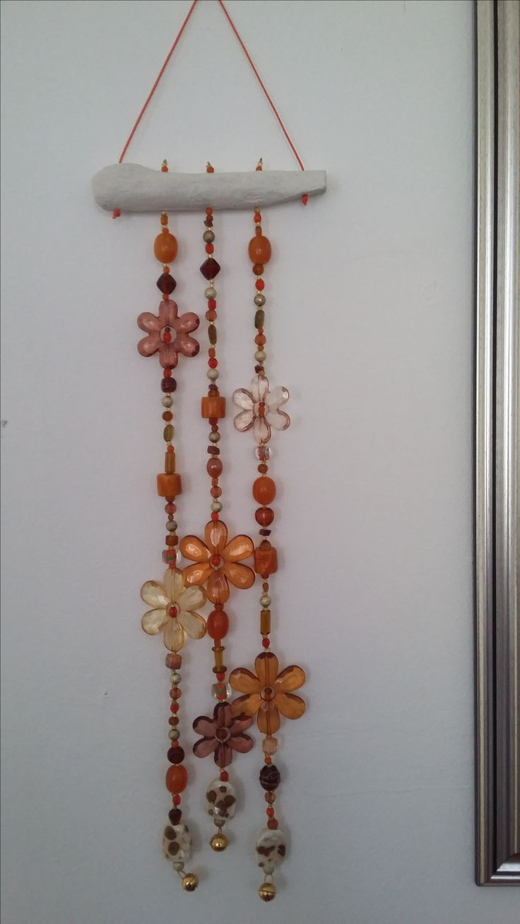 Three string wind chime in oranges and browns