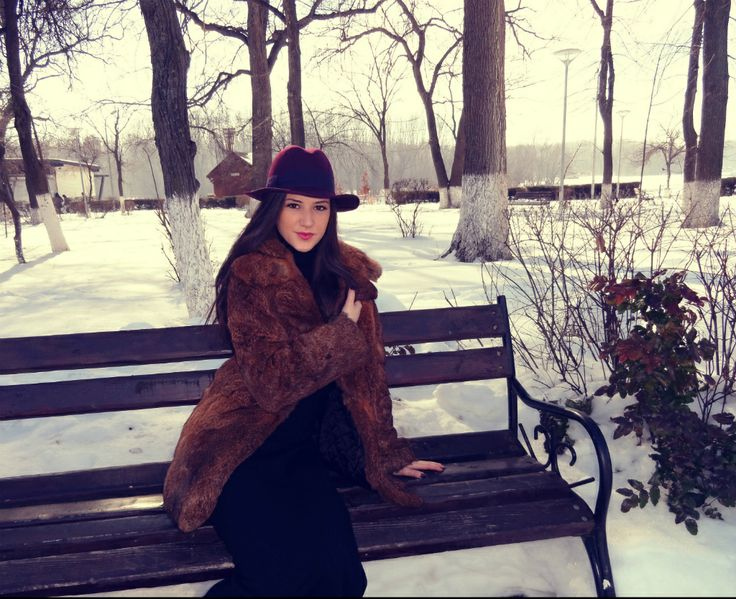 winter . snow. white. nature. purple hat. long black dress. natural fur