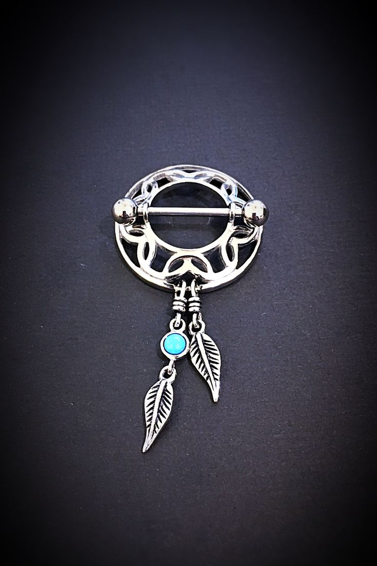 Nipple shield with dangling feathers from Angel Body Jewellery.