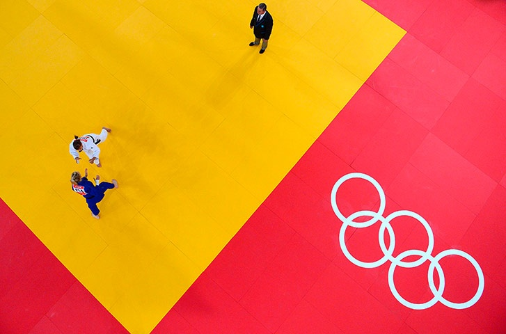 Robotic camera: France's Automne Pavia, in white, competes with Hungary's Hedvig Karakas