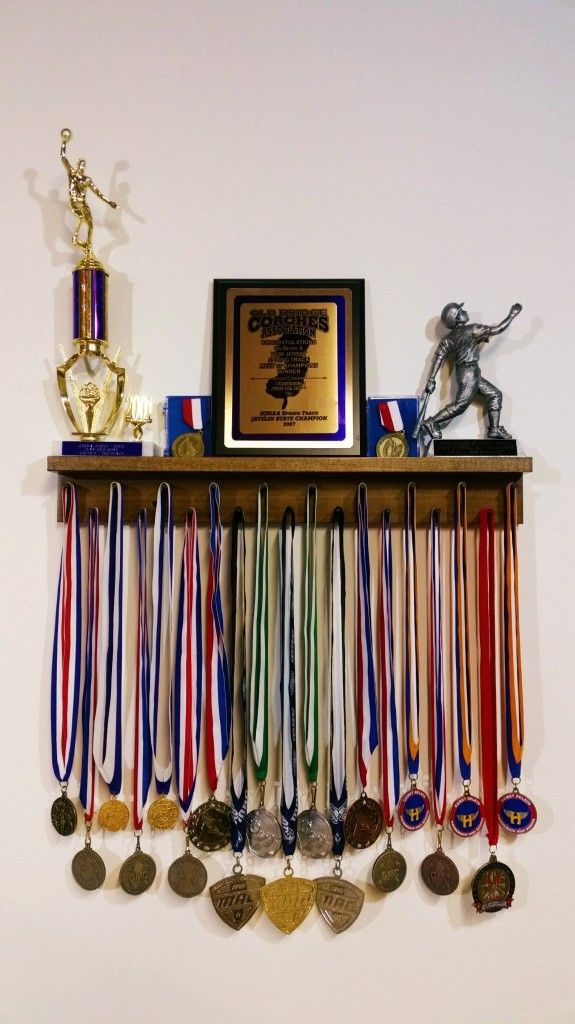 www.MedalAwardsRack.com   2 Ft Award Medal Display Rack in Walnut. Showcasing Trophies, Plaques, Cased Medals, and Lanyard Medals for display. http://www.medalawardsrack.com/category/products/