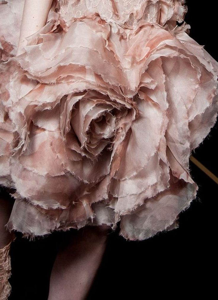 The details in this Alexander McQueen gown resemble rose petals and we're loving it | image via The LANE