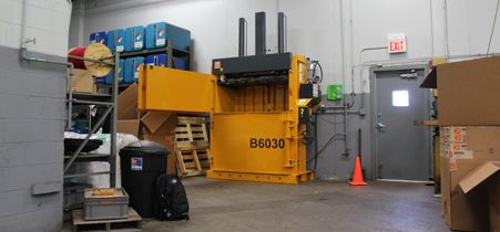 Bramidan B6030 vertical baler in machine shop used for cardboard and plastic