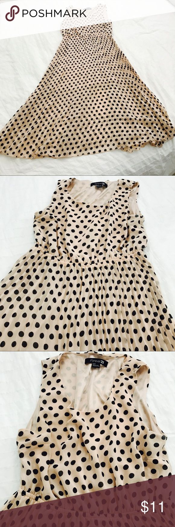 Forever 21 light pink and black polka dot dress Forever 21 light pink and black polka dot dress. The dress is pleated. It's inner lining is a shorter dress. Forever 21 Dresses Midi
