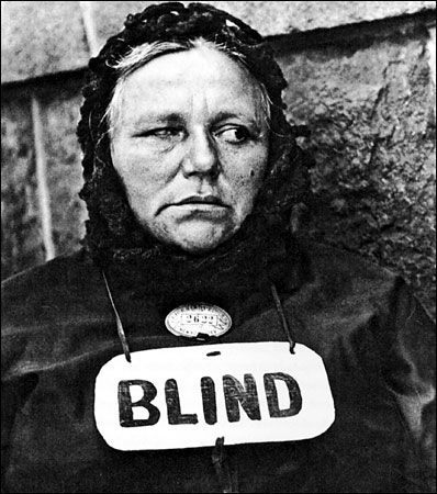 This photo shows that what you see might now always be the truth. When looking at her she doesn't seem blind but the sign says she is. Which is true? Paul Strand