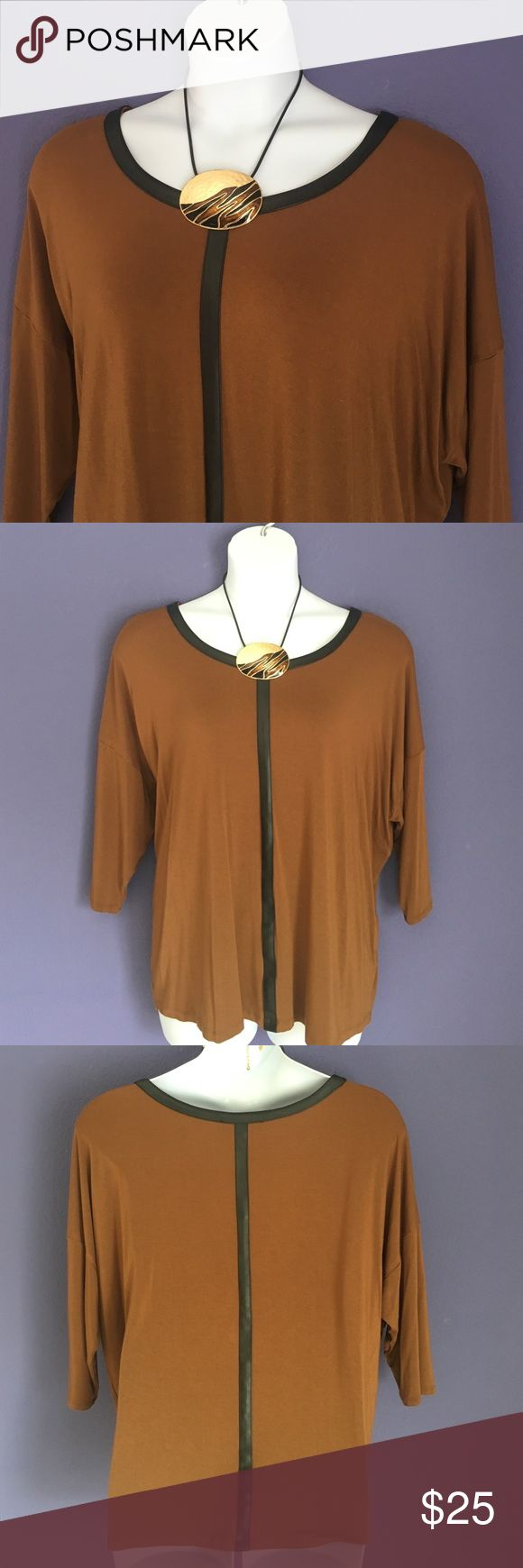 """Philosophy Brown Top w/Leather Trim This top is amazing with black pants or leggings and boots.  The faux leather trim outlines the neckline, front and back for a contemporary look.  Material:  95% Rayon/5% Spandex.  Measurements:  Length - 27.5""""/Bust - 30""""/Waist - 27.5"""" Philosophy Tops"""