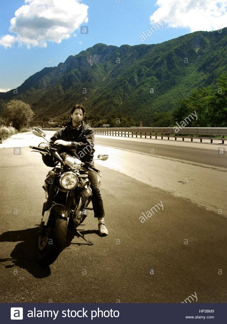 Download this stock image: Motorbike traveling in the italian alps - HP38M9 from Alamy's library of millions of high resolution stock photos, illustrations and vectors.
