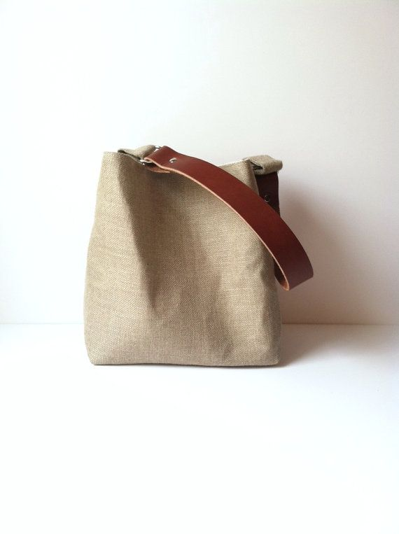 This bag is a small version of my traditional larger hobo bag. It is made from a tightly woven linen burlap fabric. This bag is fully lined