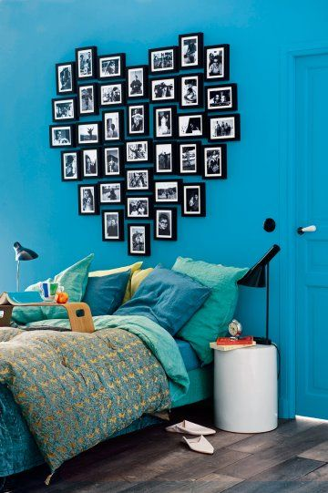 neat idea for a hallway of pictures.