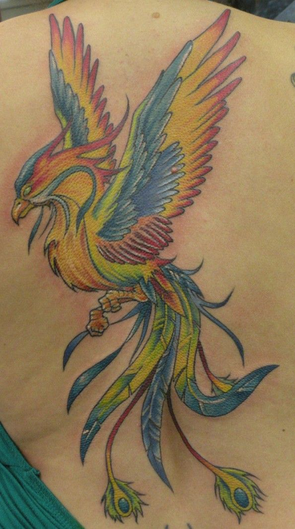 A colorful rainbow phoenix tattoo. The combination of colors symbolizes balance