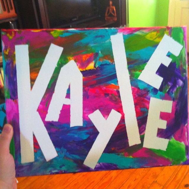 Fun project for kids! Tape off their names with painters tape. Then let them finger paint over the canvas. Remove the tape once dry. :-)