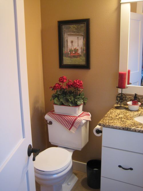 Love the idea of covering the toilet tank lid great for Outhouse bathroom ideas