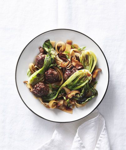Rice Noodles With Meatballs, Mushrooms, and Bok Choy | This gluten-free noodle dish is deeply satisfying, thanks to a homemade sauce seasoned with soy sauce and fresh ginger. The rice noodles are a nice change of pace from traditional pasta, and there are a wide variety of shapes to choose from. The ones pictured here are pad thai noodles, which are wider and flatter than other Asian noodles. And though technically this is a stir-fry, you don't need a wok—a large skillet will get the job…