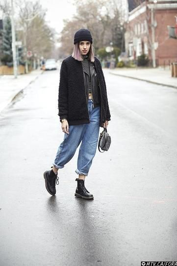 How to style your black booties - Doc marten's, cuffed boyfriend jeans, a stripe crop top + black coat and beanie. Major cool girl vibes.