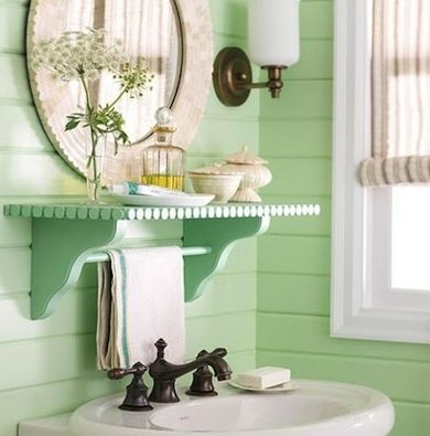 If your bathroom is feeling cramped, you can create extra storage space by mounting a shallow ledge near your sink.