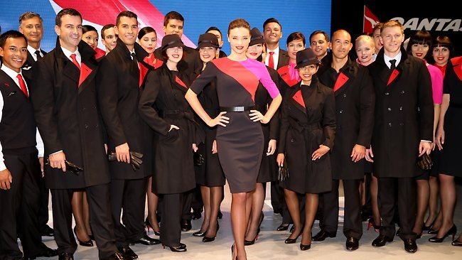 FRENCH navy, red and a splash of hot pink are the calling cards for the new Qantas uniform unveiled with a huge runway show in Sydney this morning.