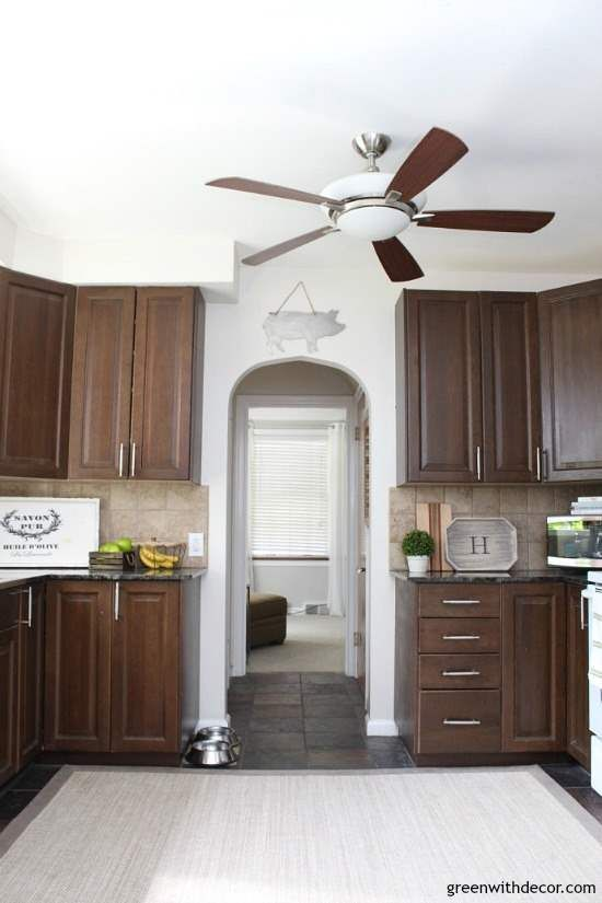 How To Brighten Up A Dark Wood Kitchen One Year In The Rental House Rental Decorating Ideas Best Neutral Paint Colors Dark Brown Cabinets Kitchen Colors