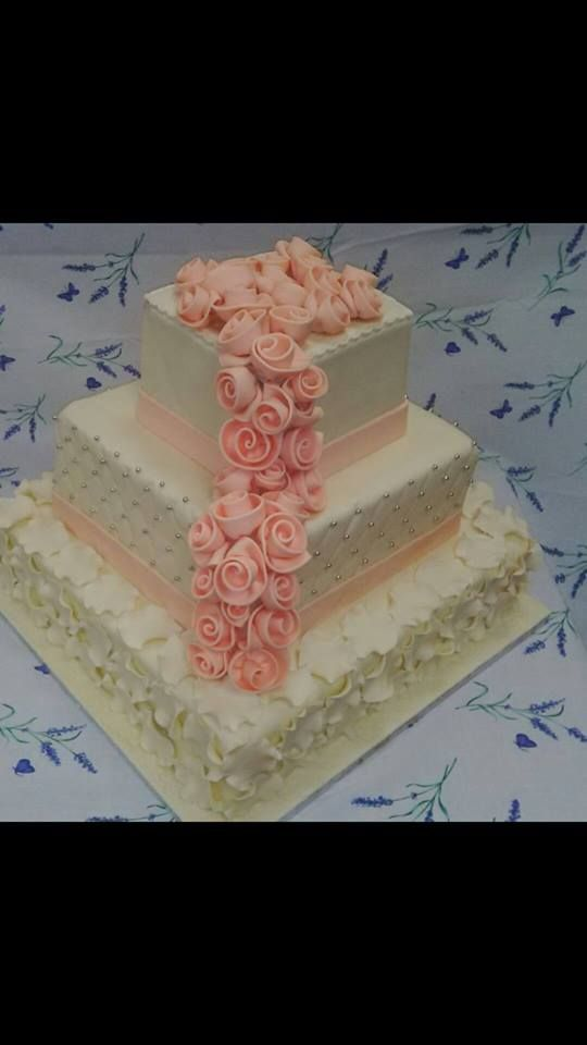 3 Tier, chocolate and vanilla, wedding cake made with hand made roses by Papali from Altefyn cakes