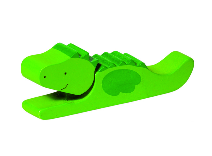 Natural and high quality toys to the development of the skills of children. Clapping crocodile