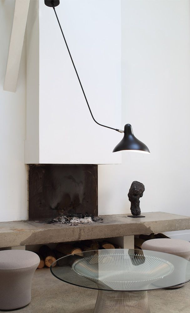 Simple Fire place and Mantis ceiling lamp designed by Bernard Schottlander