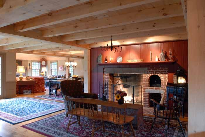 Interior Of Post And Beam Cape House With Fireplace And