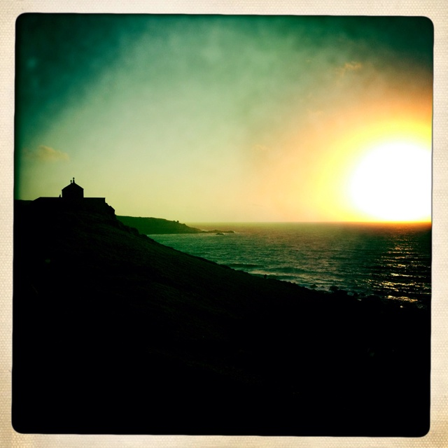The silhouette of the Chapel of St. Nicholas, St. Ives at sunset