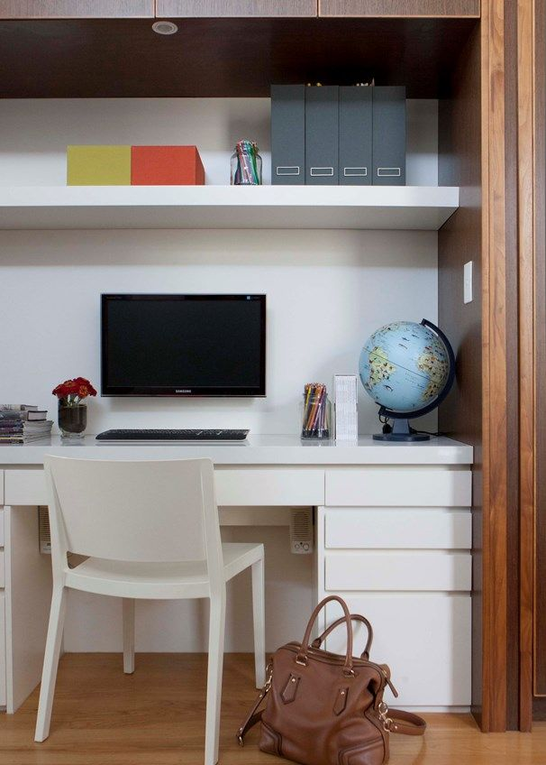 A study nook with built-in storage sits in the hallway separating the boys' bedroom from their parents'.