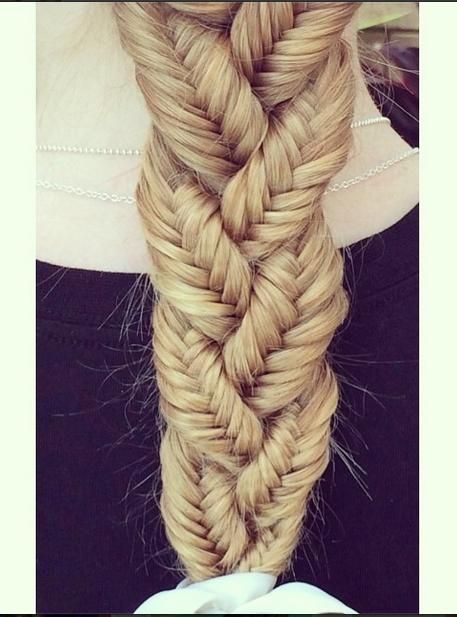 This amazing hairstyle is surprisingly simple! All you have to do is make 3 mini fishtail braids and then braid the three regularly. It would be even cooler if you did three regular braids of three fishtail braids and then regularly braided those. More
