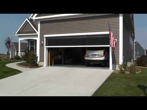 Retractable screen for garage door great ideas pinterest for Motorized garage door screens