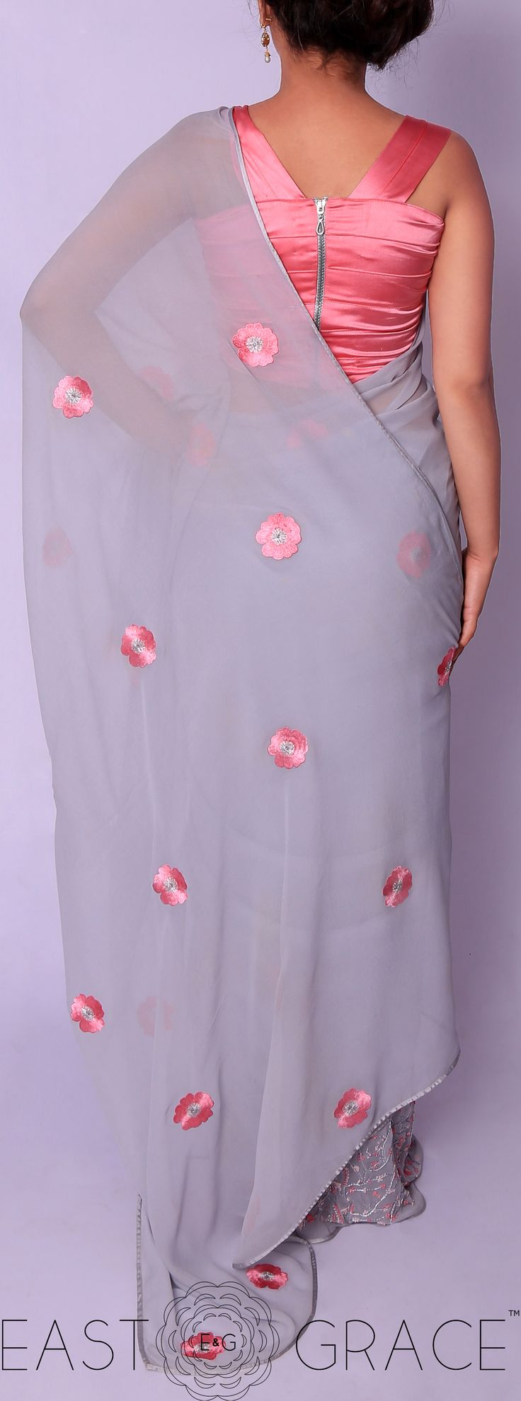 Presenting a light steel blue pure georgette saree with Briar Rose flowers, hand-crafted in silk thread embroidery all over the pallu. The skirt of the saree has climbing cherry blossom floral vines decorated with pink French knots. #saree #lehenga #indowestern #eastandgrace #love #indianwedding #onlineshopping #indianfashion #pastel #satin #ribbon #lightsteelblue #nature #handembroidered #puregeorgette