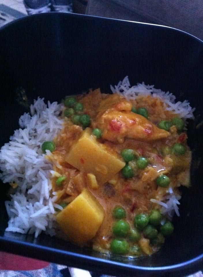 """""""Chicken Surprise"""" - the first Indian dish I ever successfully made. I adapted the recipe from one of my friends at UCA, a South Indian living in Malaysia. It is made with chicken breast, potatoes, and green peas, spices (mine is much less spicy than his), in a coconut curry base. My kids favorite dish."""