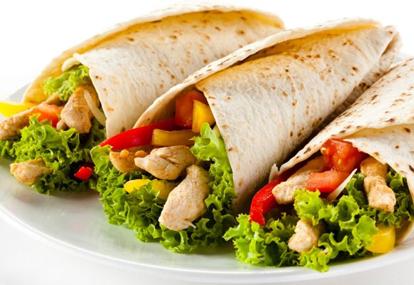 POST WORKOUT MEALS - Turkey Wraps:  A turkey wrap is a particularly great meal if you work out during your lunch break. It's got everything in a hand-held package. Wholegrain wraps are loaded with wholesome carbohydrates. Turkey is a lean protein source. Top this with salad and tomatoes for a boost of vitamin C. For a meat-free alternative, hummus is an excellent source of both protein and carbs.