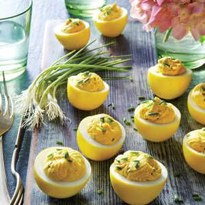 Deviled eggs get way more interesting when the eggs are pickled in a tangy brine that also dyes them a lovely color. The brine features t...