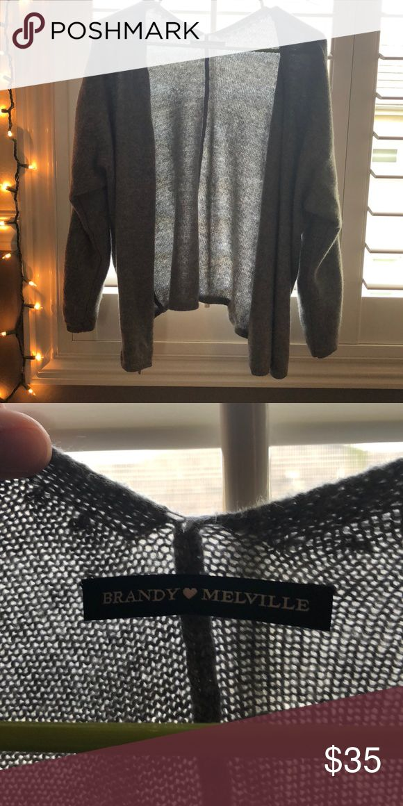Brandy Melville Cardigan Adorable brandy Melville cardigan! Never worn, no imperfections. One size in the store, but fits well on extra small/small. Super soft, and super cozy! Brandy Melville Sweaters Cardigans