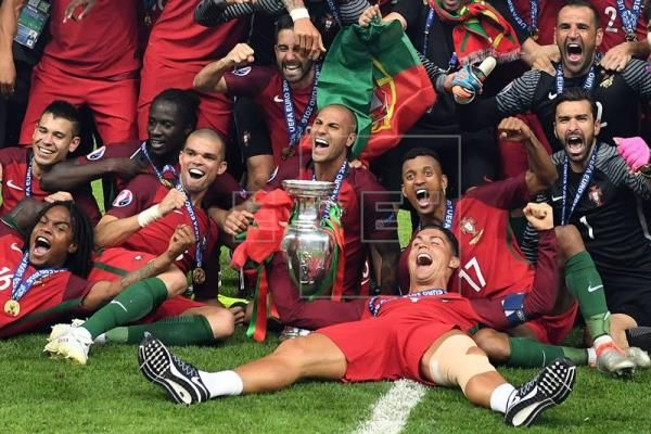 Players of Portugal celebrate after winning the UEFA EURO 2016 soccer Final match between Portugal and France at the Stade de France, Saint-Denis, France, 10 July 2016.