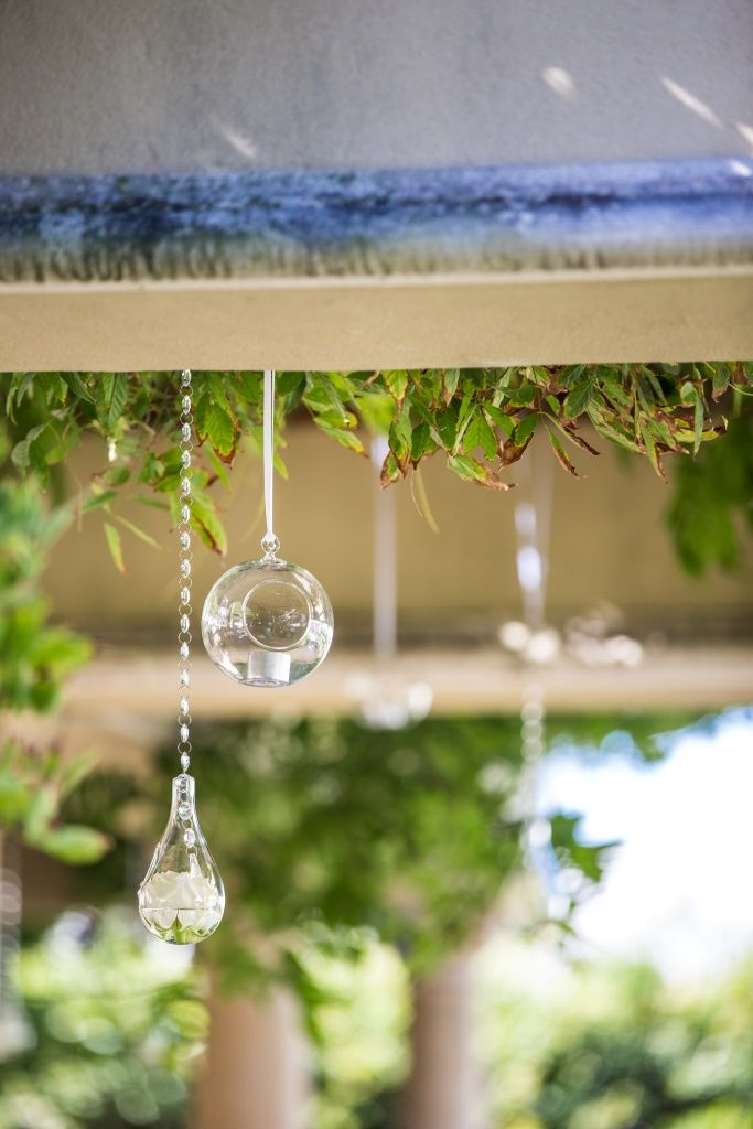 Hanging crystal drop baubles with flowers and candles www.touchedbyangels.com.au
